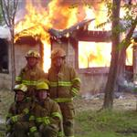 B Shift Firefighters In Front of A Fire